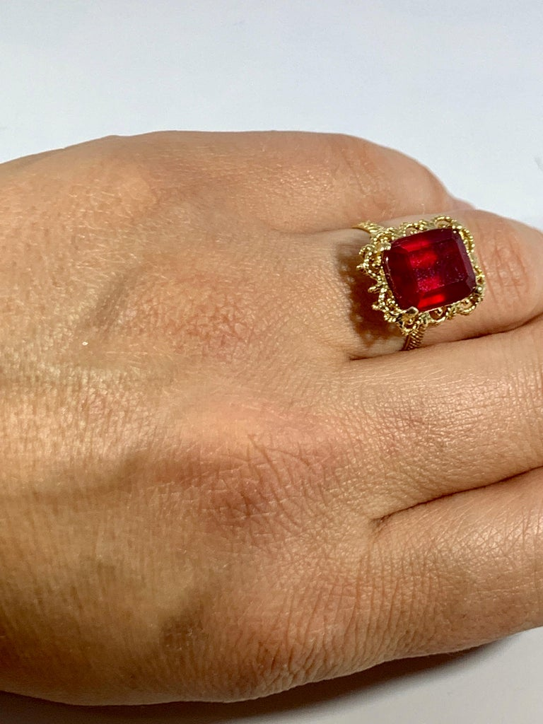 Women's Emerald Cut 7 Carat Treated Ruby 18 Karat Yellow Gold Ring For Sale