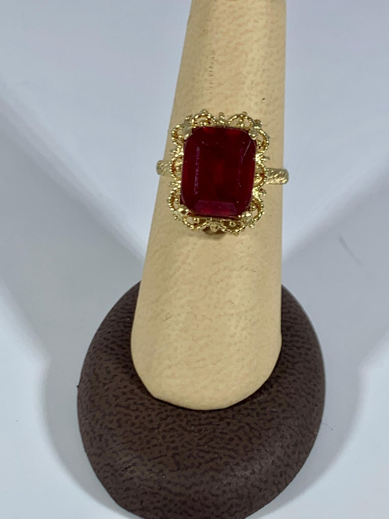 Emerald Cut 7 Carat Treated Ruby 18 Karat Yellow Gold Ring For Sale 2