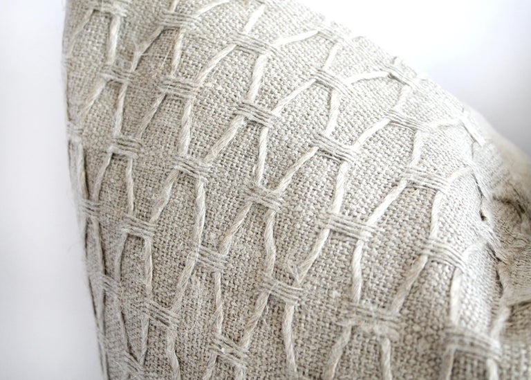 100% Belgian natural linen decorative accent pillow with a geometric pattern. Extremely soft hand, zipper closure, overlocked edges and finished in a solid natural linen backing. Down insert can be included upon request. Measures: 22 x 22, insert