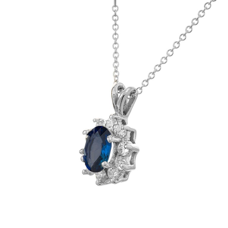 Cornflower blue Sapphire and diamond pendant necklace. Oval sapphire with a halo of 10 round ideal full cut diamonds in 18k white gold. 17.50 inch chain.   2 cornflower blue oval Sapphire, approx. total weight 1.00cts, VS2, 7 x 5mm, natural color