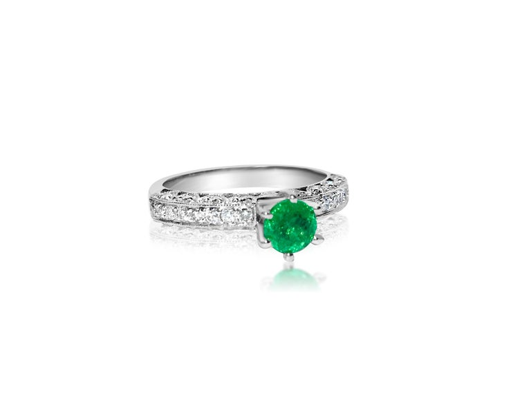 Metal: 14k white gold.  0.50 carat diamonds. VS clarity and G color. Round brilliant cut diamonds.  0.50 carat emerald. 100% natural earth mined Colombian Emerald.  TCW of all precious stones are 1.00 carat. Womens emerald diamond cocktail