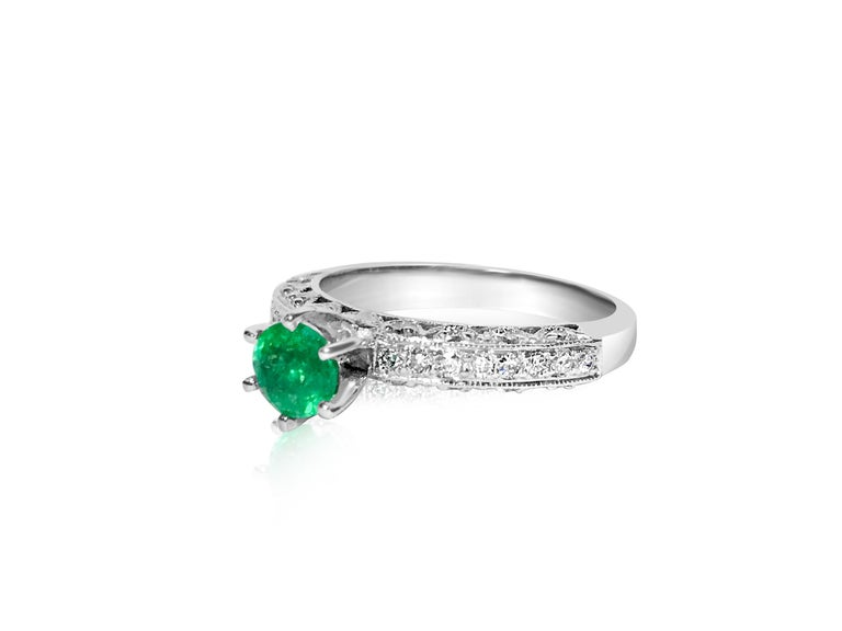 Modern 1.00 Carat Colombian Emerald Diamond Engagement Ring For Sale