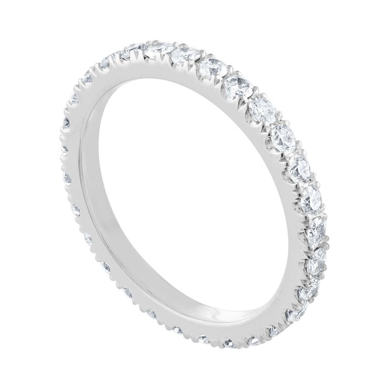 The ring is Platinum There are 1.00 Carats In Diamonds G/H SI The diamonds are round brilliant The ring weighs 3.0 grams The ring is a size 6.00, not sizable.