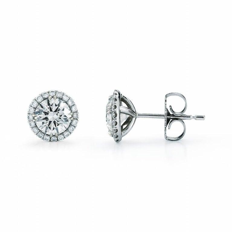 Round Cut 1.00 Carat Diamond Halo Stud Earrings in 14 Karat White Gold, by The Diamond Oak For Sale