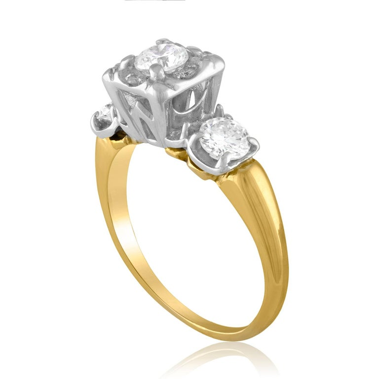 The ring is 14K White & Yellow Gold The Diamonds are Round Brilliant The 3 Round diamonds are 0.30 Ct Each The 4 small diamonds around the center stone are 0.10 Ct. All diamonds total 1.00 Carats G VS/SI The ring weighs 3.80 grams The ring is a size