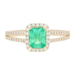 1.00 Carat Emerald and Diamond Ring, 14 Karat Yellow Gold Halo