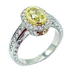 1.00 Carat Fancy Yellow Oval Diamond Platinum and Yellow Gold Engagement Ring