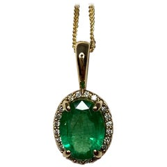 1.00 Carat Green Emerald & Diamond 18 Karat Gold Oval Cut Halo Pendant Necklace