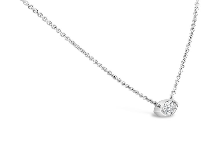 A simple and classic piece showcasing a 1.00 carat marquise cut diamond, set horizontally in a polished bezel made in 14k white gold. Suspended on an 18 inch white gold chain. Diamond is approximately H color, SI2 clarity.   Style available in