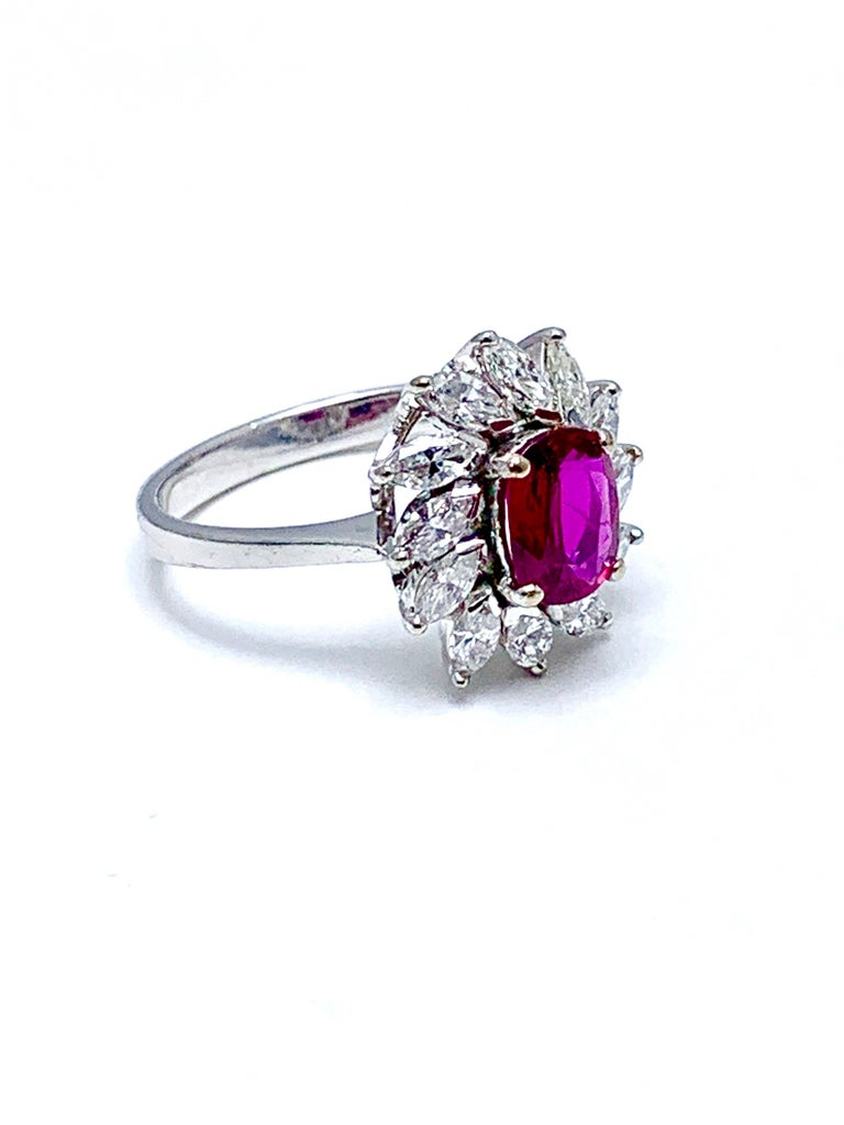 Retro 1.00 Carat Oval Ruby and Marquise Diamond Halo White Gold Ring For Sale