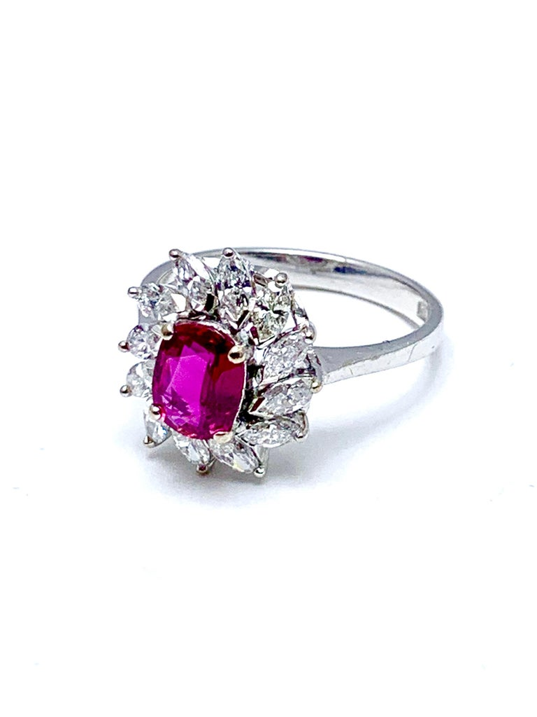 Marquise Cut 1.00 Carat Oval Ruby and Marquise Diamond Halo White Gold Ring For Sale