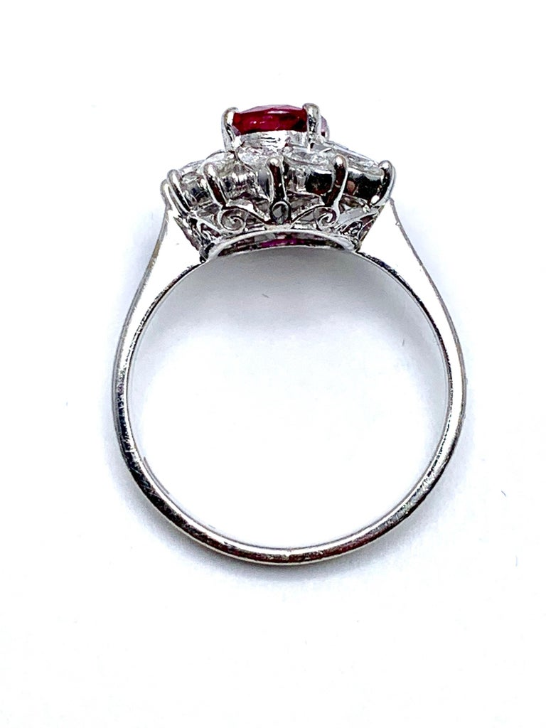 Women's or Men's 1.00 Carat Oval Ruby and Marquise Diamond Halo White Gold Ring For Sale