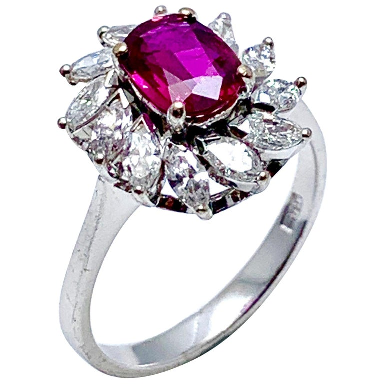 1.00 Carat Oval Ruby and Marquise Diamond Halo White Gold Ring For Sale