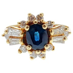 1.00 Carat Oval Sapphire and Diamond Vintage Ring in 14 Karat Yellow Gold