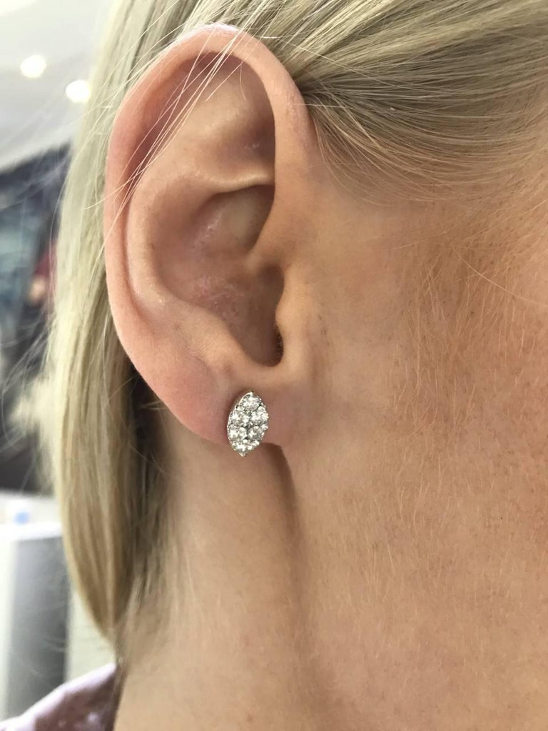 These eye catching elegant Round Brilliant Diamond cluster stud earrings featuring H-SI diamonds that sparkle, set in 18 Carat White Gold. These Marquise shaped pave set cluster studs have a total diamond weight of 1.00 Carats and a measurement of