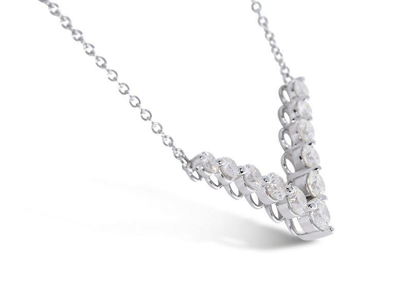Modern 1.00 Carat Round Diamond Chevron Necklace in 14 Karat White Gold. Certified by IGI Laboratory in New York, with full diamond jewelry grading report.  1.00 Carats of Brilliant Round White VS-SI Diamonds and 4.00 grams of 14K White Gold.  This