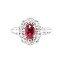 1.00 Carat Ruby and Diamond Halo Ring Set in Platinum