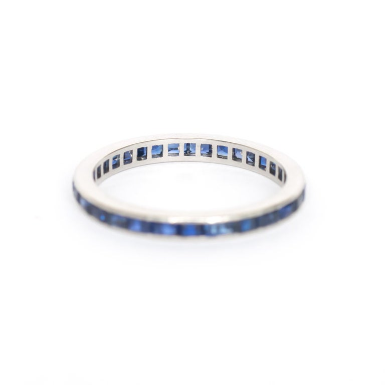 Ring Size: 5.95 Metal Type: 18 karat White Gold  Weight: 1.9 grams  Color Stone Details:  Type: Sapphire  Shape: Princess Cut  Carat Weight: 1.00 carat, total weight. Color: Synthetic Deep Blue   Finger to Top of Stone Measurement: 1.64mm Width: