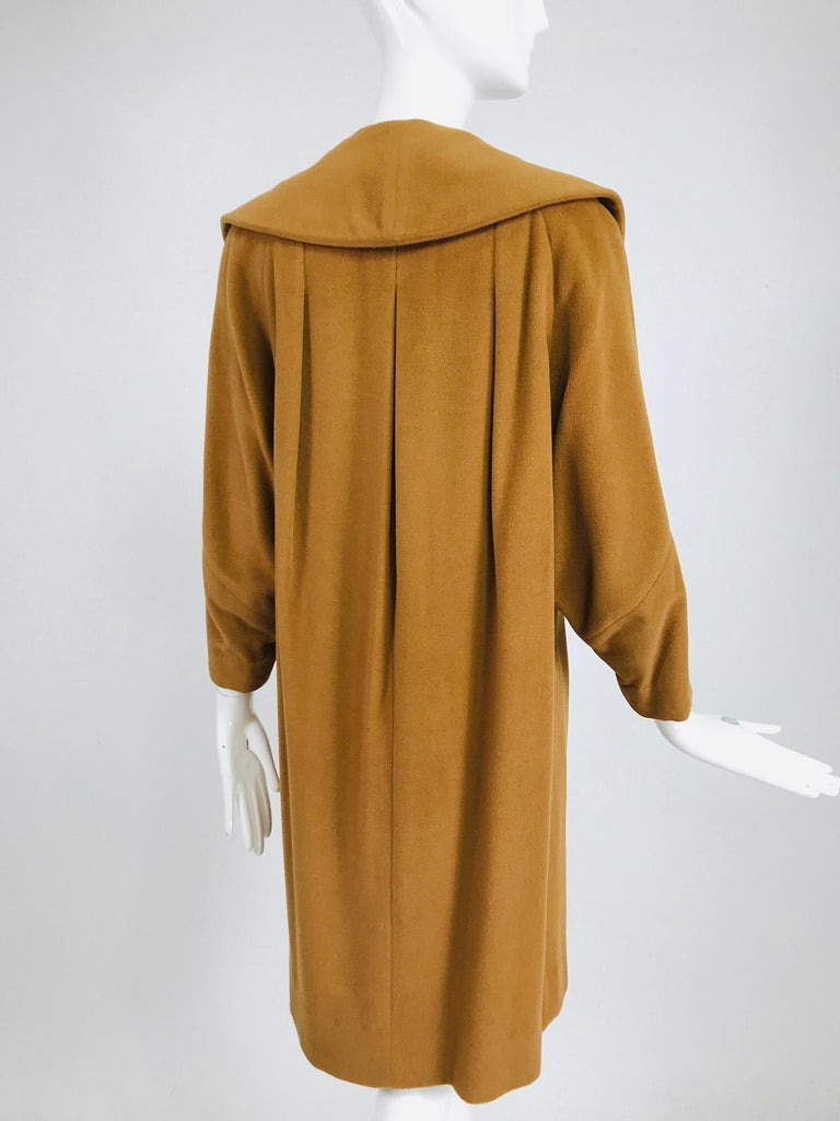 100% Vicuna 1950s women's coat in tobacco brown, vintage. This soft and beautiful coat is made from rare Vicuna wool. Early 1960s coat has a bell shape, with an unusual shaped collar. The coat has no front closures and can be worn open or held