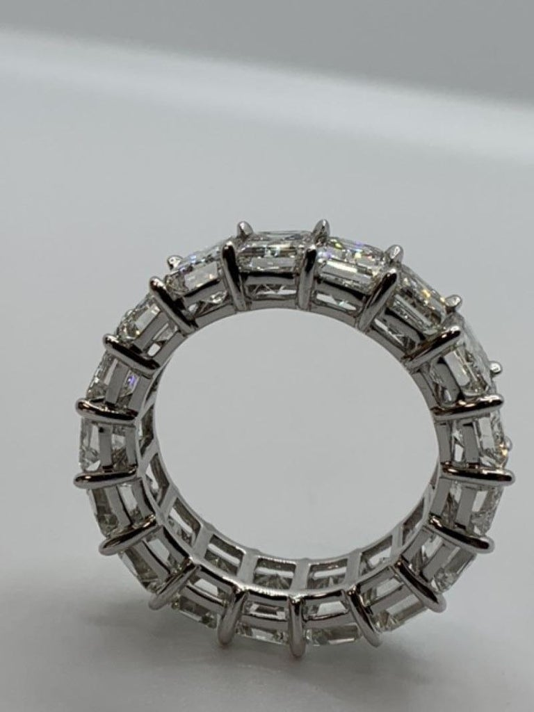 Classic Emerald Cut Diamond Eternity Band featuring 17 Stones weighing a Total of 10.0 Carats. Average is 58 Points each. Diamonds are of G-H color and VS Clarity. Set in Platinum. Size 6.5