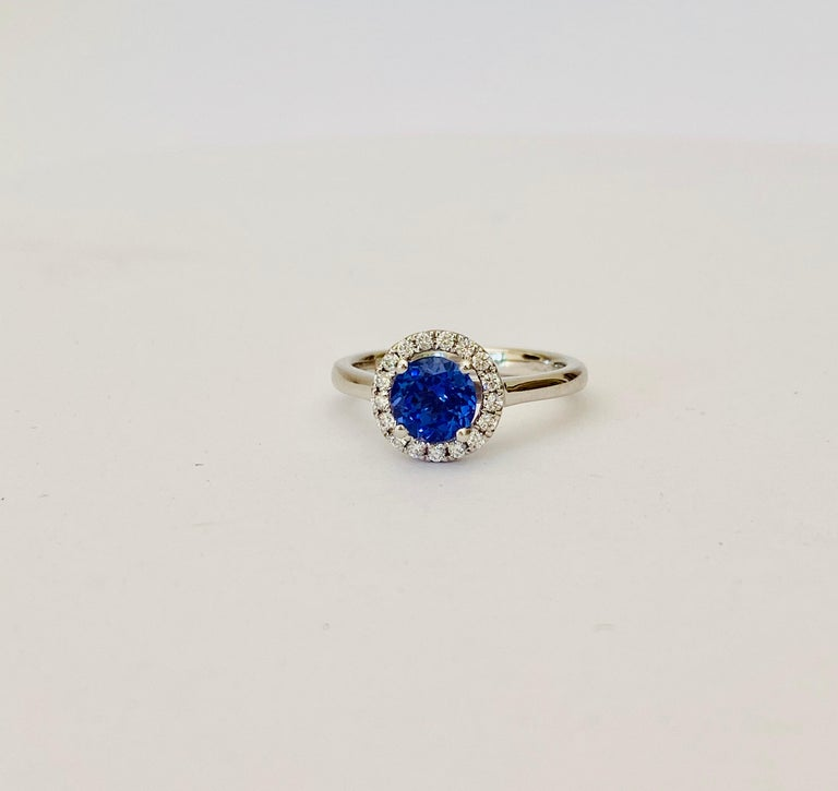 1.00 Carat Round Tanzanite in a Diamond Halo Design Set in Platinum In New Condition For Sale In Chislehurst, Kent