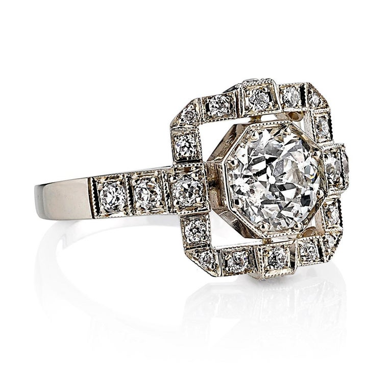 1.00ctw K/SI1 EGL certified old European cut diamond bead set in a handcrafted 18K champagne white gold mounting. 0.52ctw bead set old European cut accent diamonds surround the center stone and drape down both sides of the shank.  Ring is a