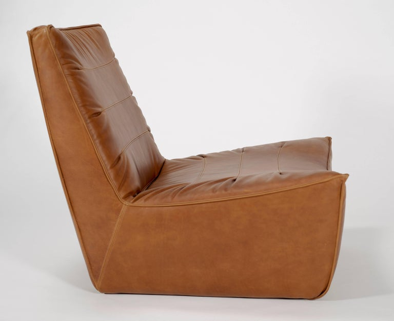 Our pinch chair is a fully upholstered chair in whiskey leather.  This comfy lounger take cues from the upholstery of 1970s Italian sports cars. The original was custom designed for a client in Los Angeles who wanted the perfect chair for listening
