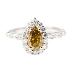 1.01 Carat Certified Fancy Yellow Pear Diamond and 0.42 Carat Engagement Ring