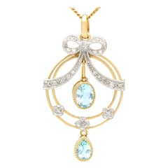 1.01 ct Aquamarine and 0.9 ct Diamond 9 Carat Yellow Gold Pendant, Antique Style