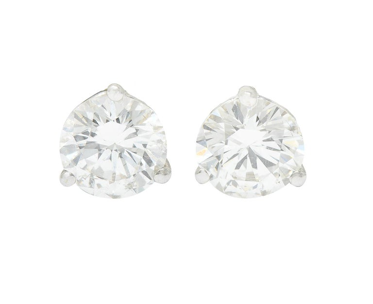 Featuring martini basket stud earrings set with round brilliant cut diamonds  Weighing in total approximately 1.20 carats with I/J color and SI clarity  Completed by threaded posts and screw backs  With stud enhancers as a flange surmount that