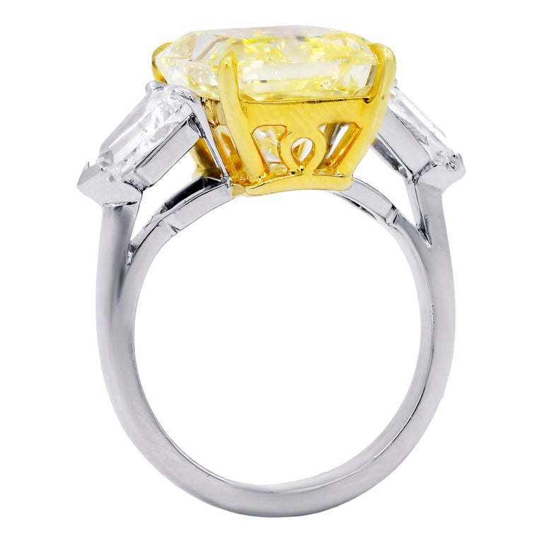 Magnificent Three stone Canary Yellow Diamond ring, features 10.15 carats Fancy Yellow, SI2 in Clarity. 100% Eye clean no visible inclusions. Set with 1.80 Carats of Bullets in Platinum GIA #17480434