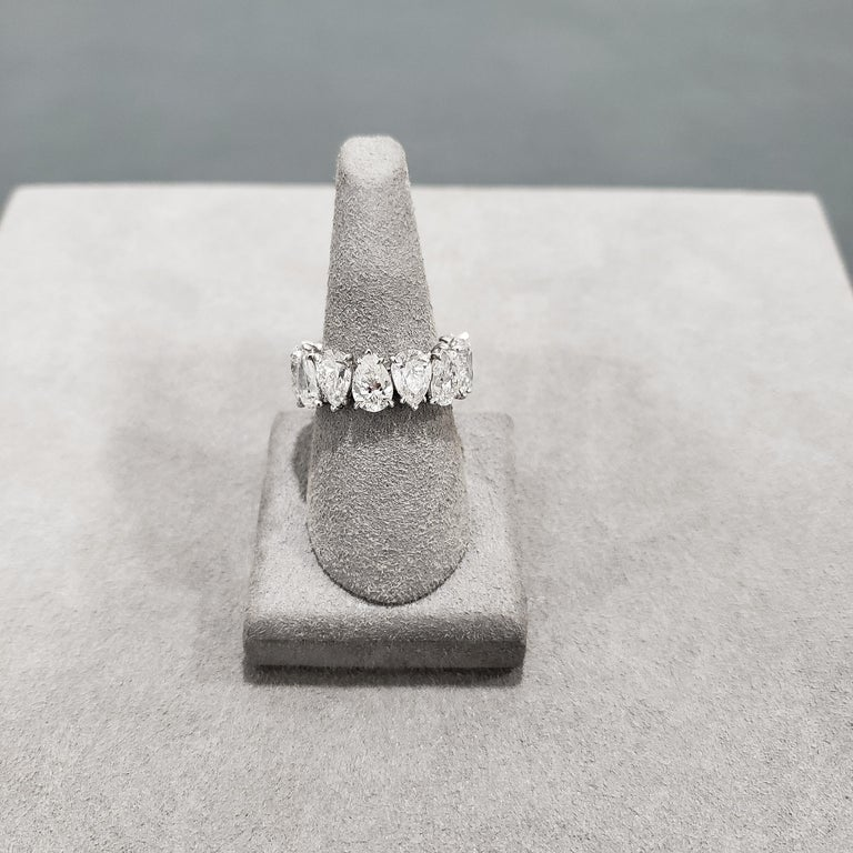 This wedding band features 14 pear-shape diamonds weighing 10.17 carats, set in an alternating direction. The ring made in platinum. Ring size 6 US. A creative and unique ring.   Style available in different price ranges. Prices are based on your