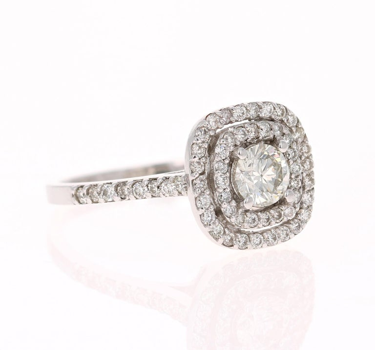 Beauty lies within the eyes of the beholder...This is simply a gorgeous ring.   The center round cut diamond weighs 0.52 Carats (Clarity: SI1, Color: J) and is surrounded by 62 round cut diamonds that weigh 0.50 Carats (Clarity: SI, Color: H) The