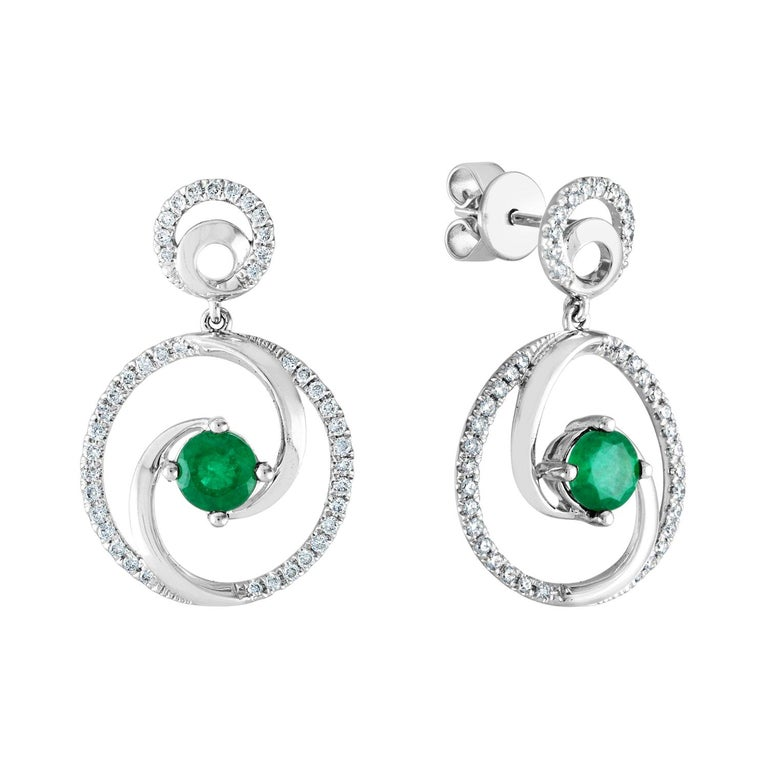 1.02 Carat Emerald Diamond Gold Dangle Swirl Earrings For Sale