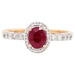 1.02 Carat Oval Ruby and Diamond 18 Carat White and Yellow Gold Engagement Ring