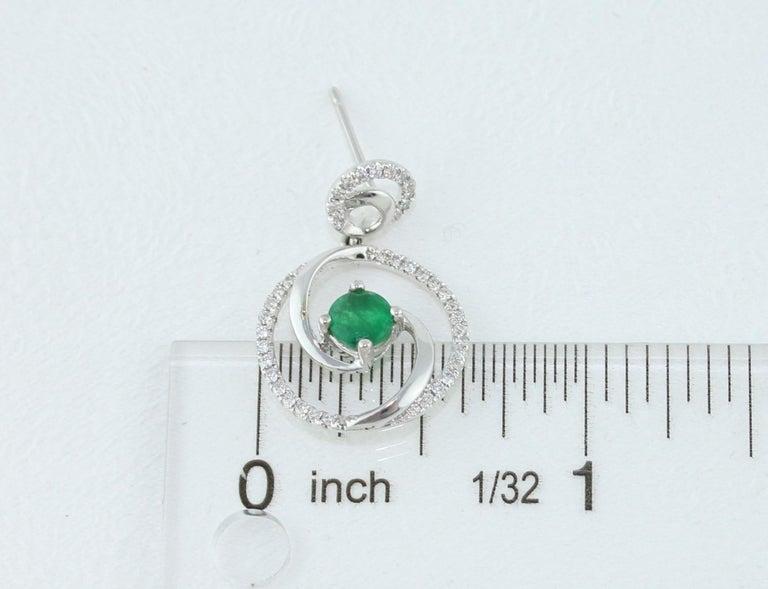 1.02 Carat Emerald Diamond Gold Dangle Swirl Earrings For Sale 1