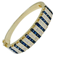 10.20 Carat Princess Cut Diamond and Sapphire Yellow Gold Bangle Bracelet