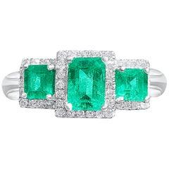 1.03 Carat Colombian Emerald, Diamond, and 18 Karat White Gold Three-Stone Ring