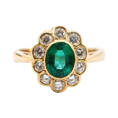 1.03 Carat Oval Emerald and Diamond 18 Carat Yellow Gold Vintage Cluster Ring