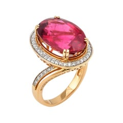 10.34 Carat Oval Shaped Rubelite Ring in 18 Karat Yellow Gold with Diamonds
