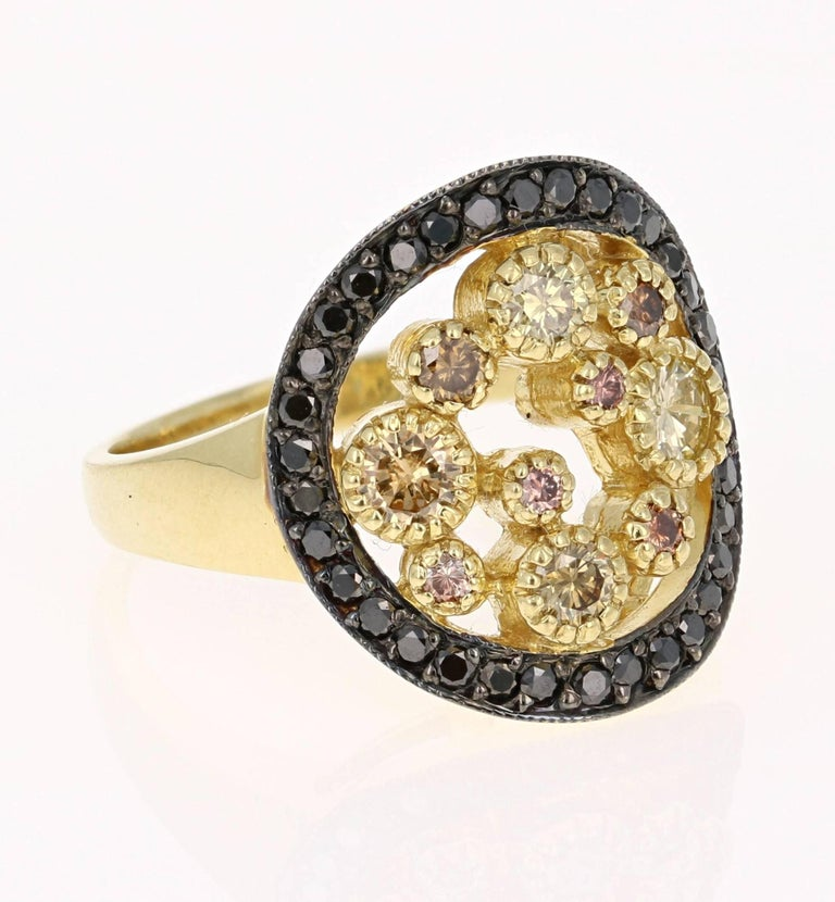 Gorgeous Black Diamond and Natural Fancy-Colored Diamond Cocktail ring.  This ring has 10 Natural Fancy-Colored Diamonds floating in the center of the ring that weigh 0.65 carats and are surrounded by 34 Round Black Diamonds that weigh 0.39 carats.