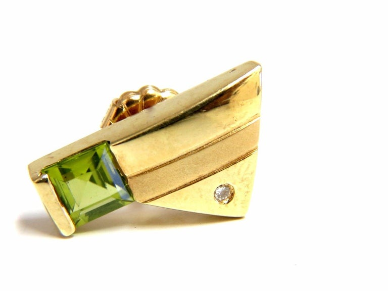 Modern Deco:  Gorgeous brilliance,  1.00ct. Natural Bright Green Peridot  Fully Faceted for maximum brilliance  Clean Clarity and transparent  Asscher cuts  5 X 4mm each.    .04ct. diamonds,  Rounds and full cuts.  Flush / Bezel set  14kt. yellow