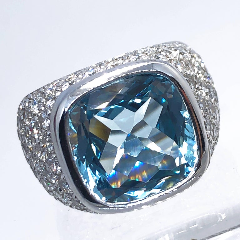 Outstanding Brazilian Aquamarine Antik Cut (10.43 kt, 13.5x13.5mm) in a Sumptuos (3.74 kt, F-G, Vvs1) White Diamond 18K White Gold Setting.  In a fitted burgundy leather case. A detailed certificate of this awesome piece is included. US size 7
