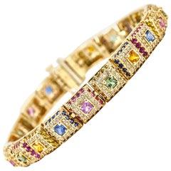 10.47 Carat 14 Karat Yellow Gold Diamond Multi-Color Sapphire Bracelet