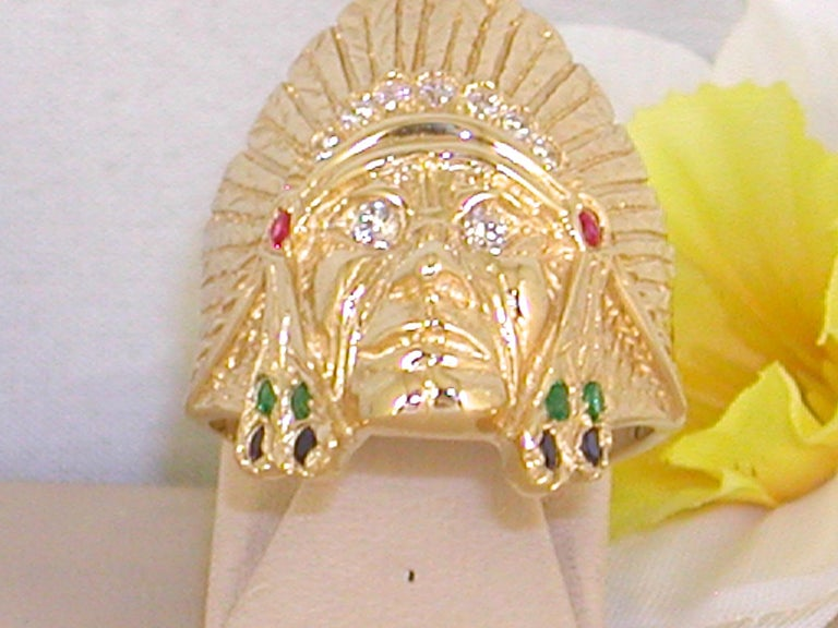 Gold: 18 Yellow gold  Weight: 15.83 grams  Diamonds: 0.55 ct. Colour: G  Clarity: VS2  Emeralds: 0.20 ct. Rubies: 0.10 ct. Sapphires: 0.20 ct. Ringsize: We can resize the ring at no extra cost Width: 2.60 cm. / 1.00 inch Condition: Brand New  All