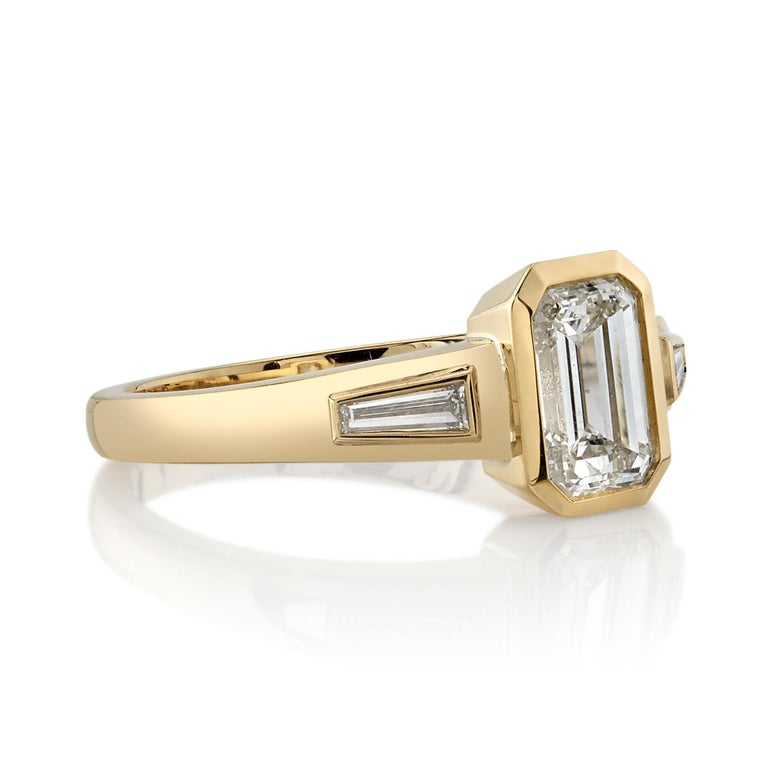1.05ctw J/VS2 GIA certified Emerald cut diamond with 0.15ctw tapered Baguette cut accent diamonds set in a handcrafted 18K yellow gold mounting.  Ring is currently a size 6 and can be sized to fit.