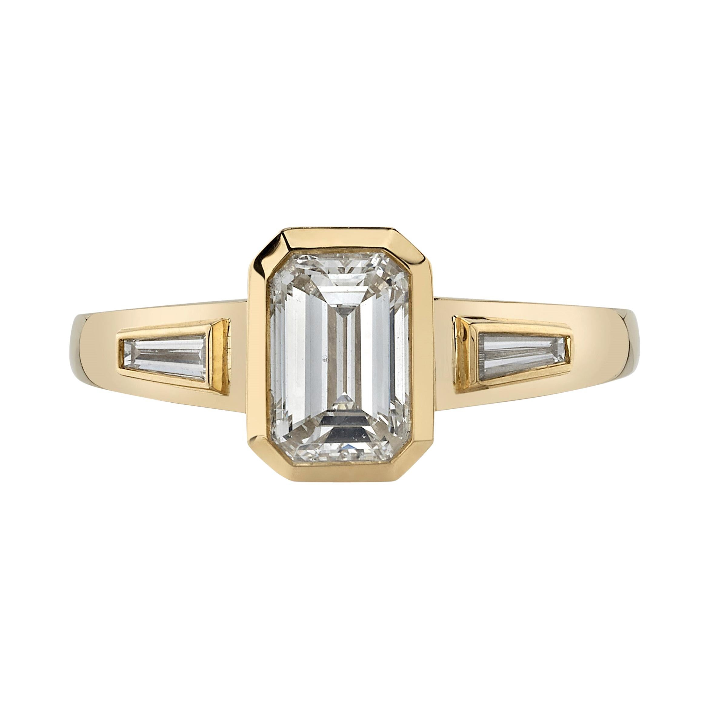 1.05 Carat Emerald Cut Diamond Set in a Handcrafted Yellow Gold Engagement Ring