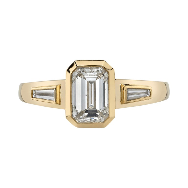 1.05 Carat Emerald Cut Diamond Set in a Handcrafted Yellow Gold Engagement Ring For Sale