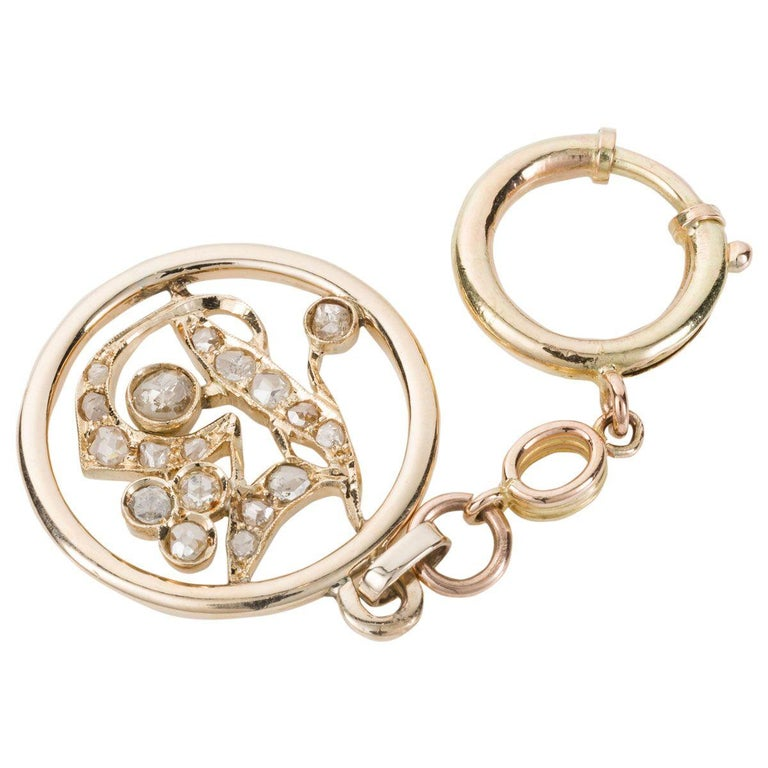 Something very unique, a true one-off piece. This unusual key chain is encrusted with approximately 1.05cts of old rose cut diamonds that twinkle brightly in the shape of a number 13. A very lucky number for some, maybe representing a birth date,