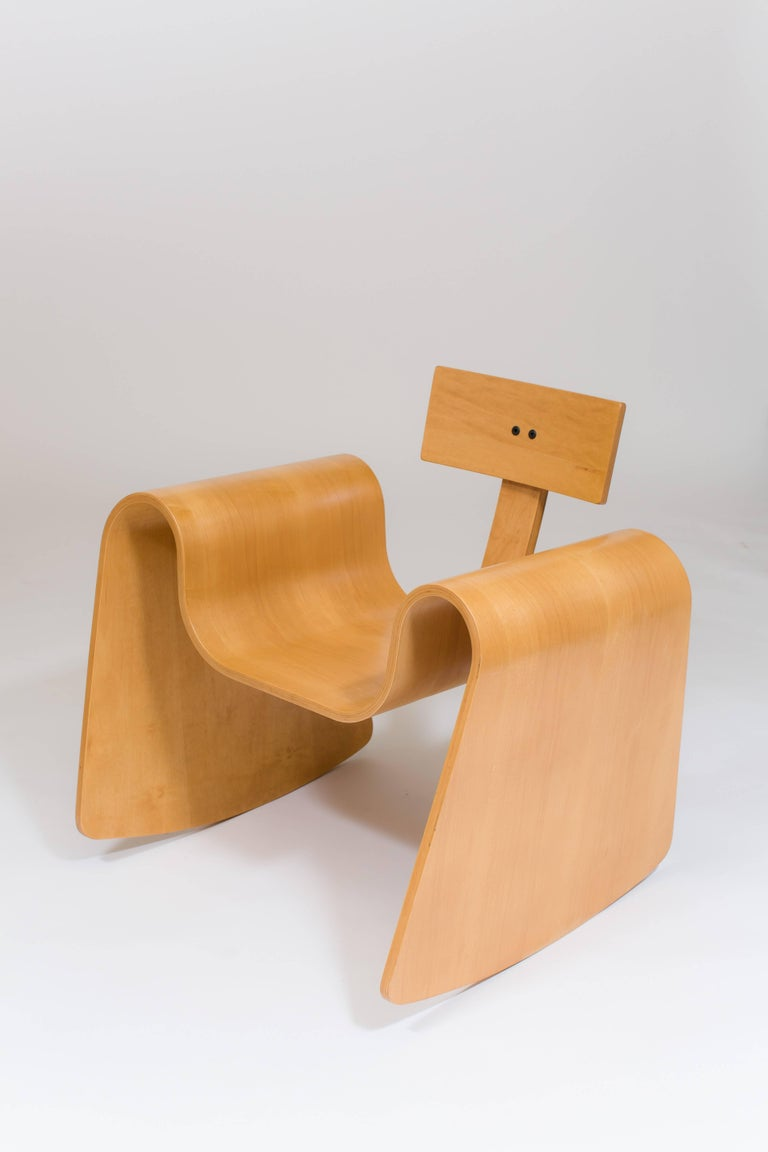 The 105 rocking chair is made from thin sheets of birch and maple that have been compressed, molded and cut into a seamless, contoured rocking chair.  The complex curves in this rocker are made possible by a technology called Radio Frequency Gluing